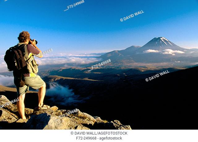 Photographer and Mt. Ngauruhoe. Tongariro National Park, Central Plateau. North Island. New Zealand