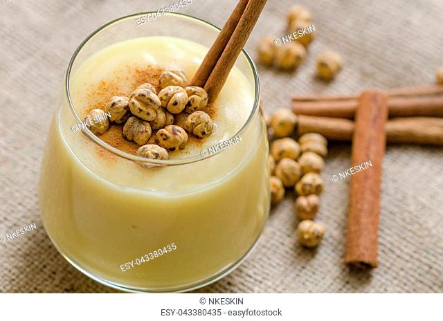 Boza or Bosa, traditional Turkish drink with roasted chickpeas and cinnamon on the table