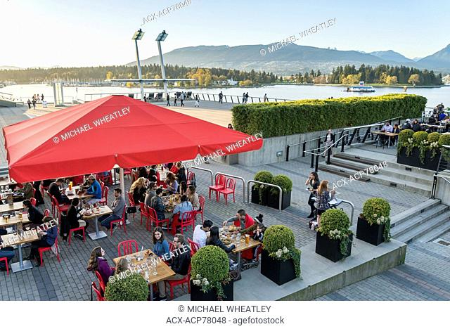 People eating at outdoor patio, Jack Poole Plaza, Vancouver, British Columbia, Canada