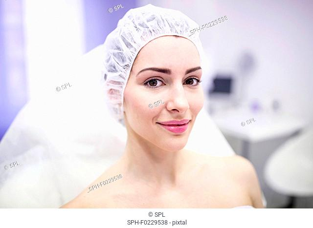 Woman wearing surgical cap in clinic