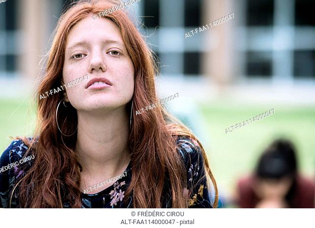 Young woman outdoors, portrait