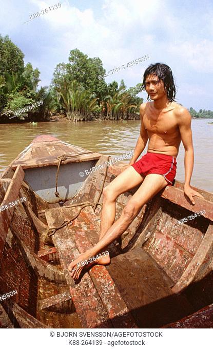 Fisherman on Mekong River, near Saigon. Vietnam