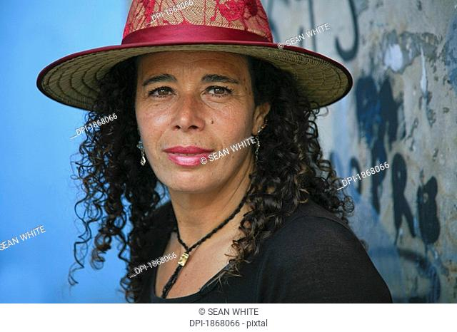 woman wearing a hat, caminito district, buenos aires, argentina