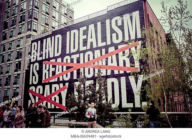 Billboard Blind Idealism is reactionary scary deadly, The High Line is a public park built on a historic freight rail line elevated above the streets on...
