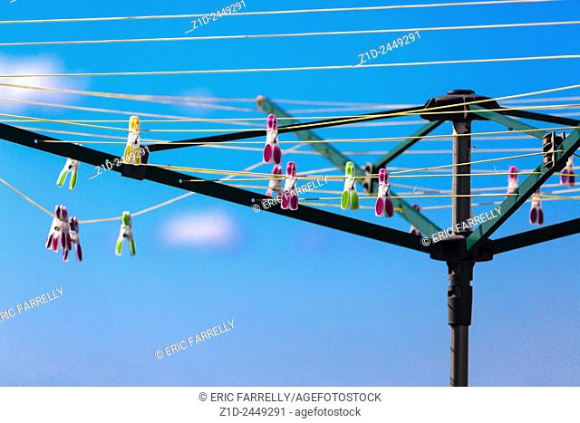clothes pegs on rotary washing line