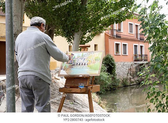 Peñafiel, Spain: Watercolor artist painting the old mill en plein air along the Duratón River in La Juderia Park