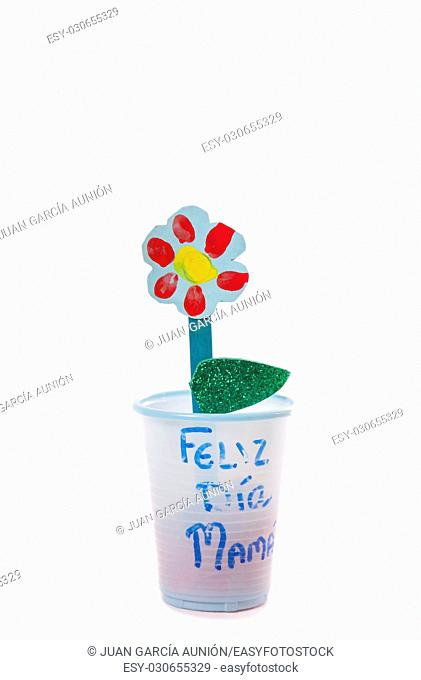 Poster board spring flowers made with recycled materials by nursery children for Mother's Day. Isolated over white background