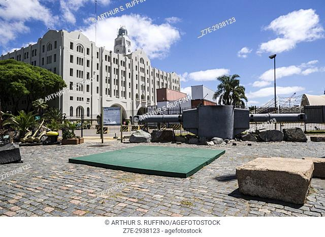 Range finder belonging to German battleship Admiral Graf Spee with National Directorate of Customs building in the background