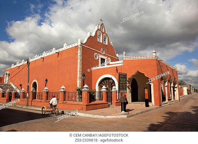 A man riding a bici-taxi near the Candelaria Church, building once functioned as a Franciscan Monastery, Valladolid, Yucatan Province, Mexico, Central America