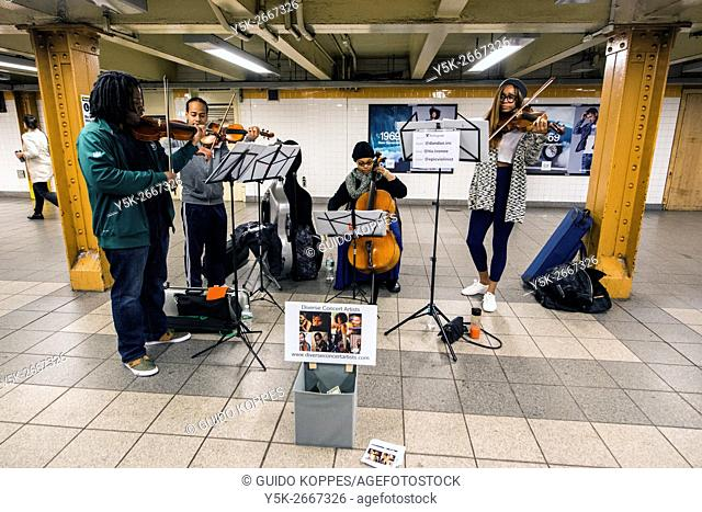 New York City, USA. African-American classical musicians playing inside an L Train subway station