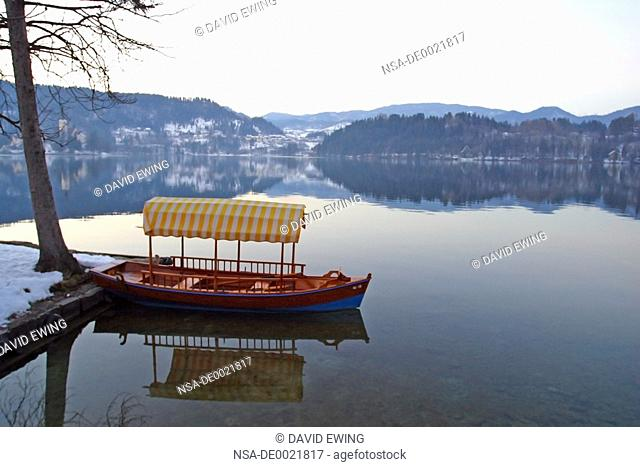 A boat sits still on Lake Bled, Slovenia