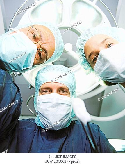 Underview, three surgeons staring down