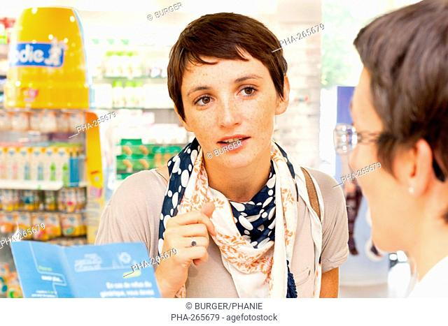 Woman buying medications in a pharmacy