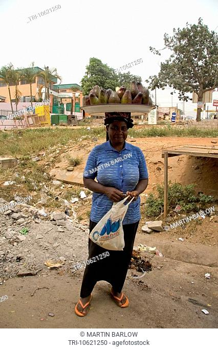 Woman selling avocados YaoundŽ Cameroon West Africa Carrying tray on head