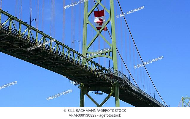 Canada Halifax Nova Scotia harbour with large famous bridge McKay Bridge with Canadian flag flying