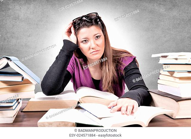 Female with contempt for learning on gray background