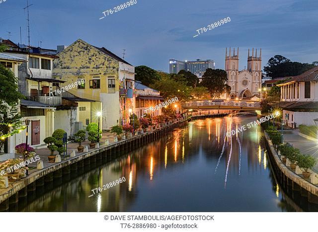 Melaka River and St. Francis Xavier church at dusk, Malacca, Malaysia
