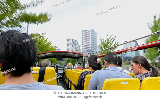Tokyo Japan temple and local traffic with tourist bus two decker taking photos of downtown city with street