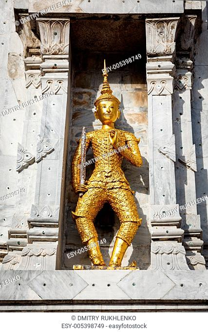 Gold guard on tower, Wat Phi, Thailand