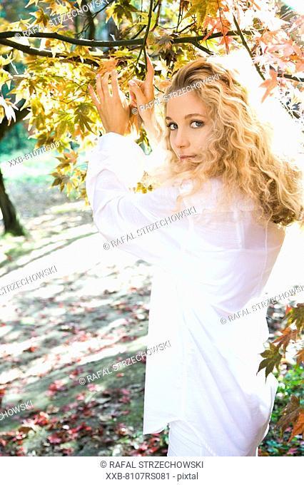 Blond woman in autumn park