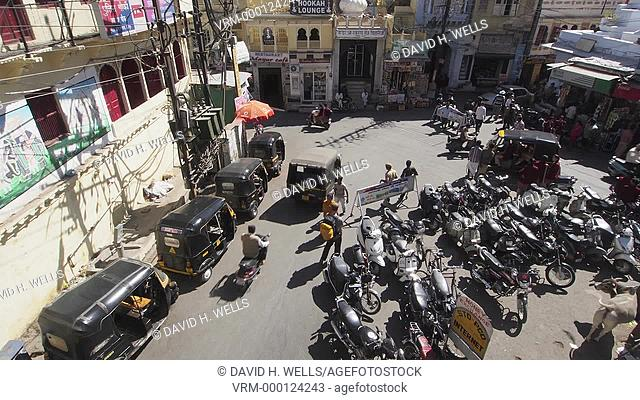 Crowded street scene in front of a building in Udaipur, Rajasthan, India