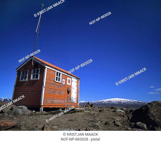 Low angle view of a cottage on a landscape