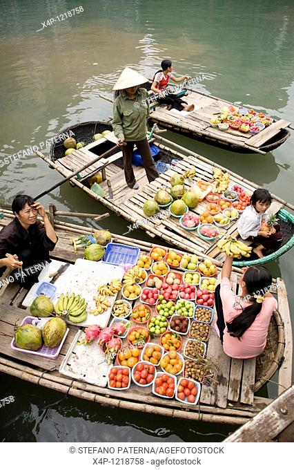 Merchants on boats in Halong Bay near Hanoi, Vietnam