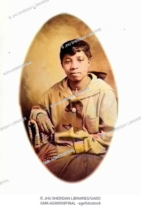 Portrait of African-American young woman in photographic studio, 1930. Note: Image has been digitally colorized using a modern process