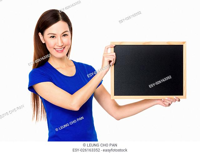 Young Woman show with clean of chalkboard