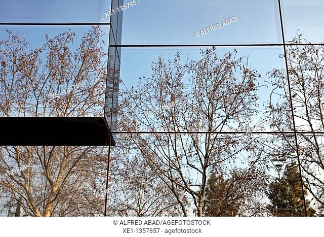 reflections of trees in the glass building, Mataro, Catalonia, Spain
