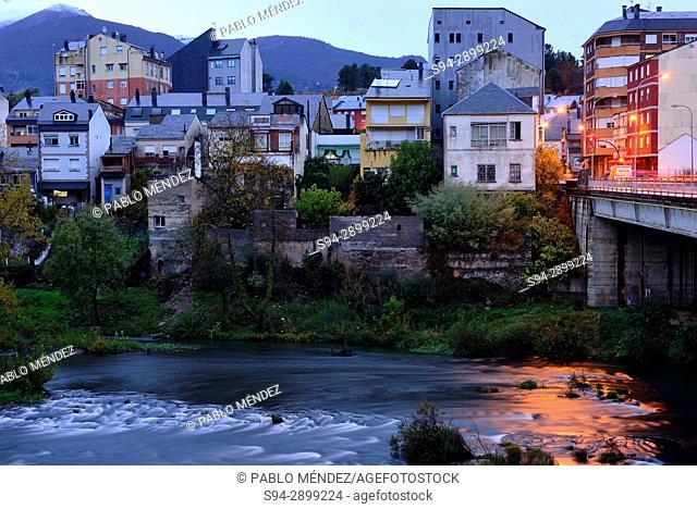 View of facades and bridge over Sil river in O Barco de Valdeorras, Orense, Spain