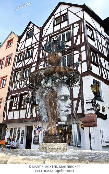 Fountain sculpture at a historic place in the Hebegasse, Bernkastel-Kues, Mosel river, Rhineland-Palatinate, Germany, Europe