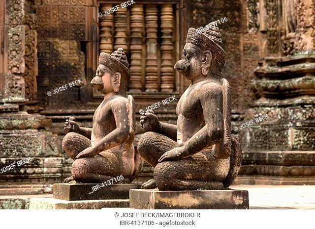 Yaksha Guardian, guardian figures in front of the Mandapa, Khmer Hindu temple Banteay Srei, Angkor region, Siem Reap Province, Cambodia