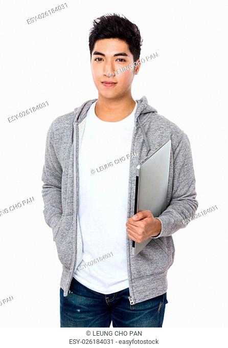 Asian young man hold with notebook computer