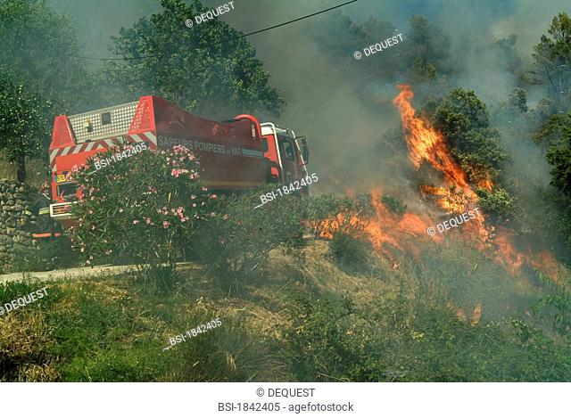 Firefighters during a forest fire near the village of Cotignac in the department of Var, France
