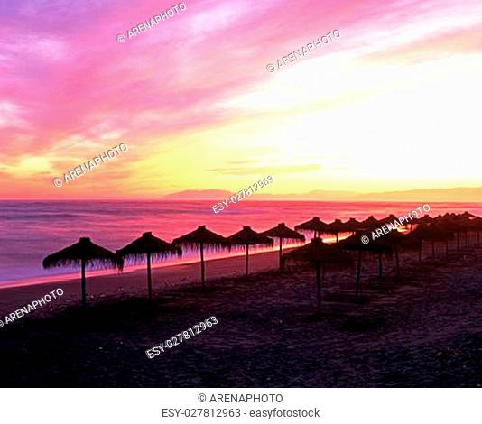 Parasols on beach at sunset, Torrox Costa, Costa Tropical, The Axarquia, Malaga Province, Andalucia, Spain, Western Europe