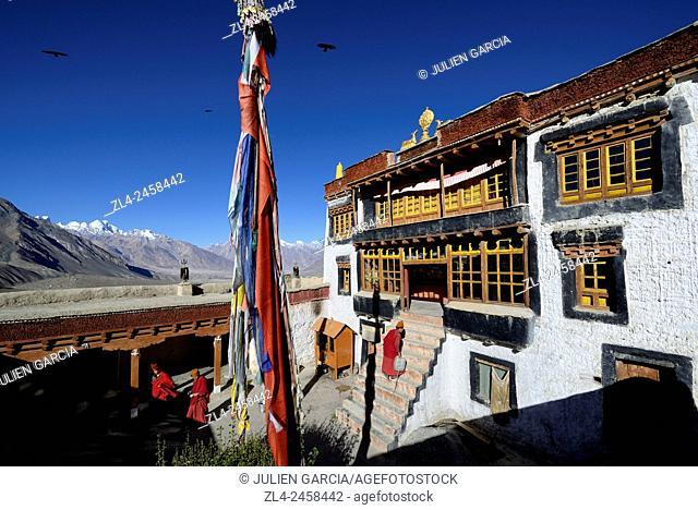 India, Jammu and Kashmir State, Himalaya, Ladakh, Zanskar, monks in the courtyard of Stongde gompa (Buddhist monastery)