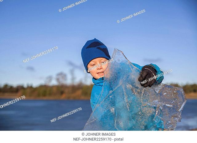 Boy holding ice