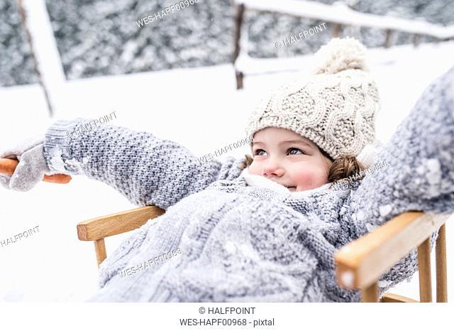 Happy girl on sledge