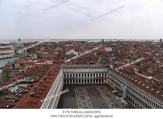 12 May 2019, Italy, Venedig: Western view from Campanile. From the Markusturm clouds lie over the city of Venice. This is where the Art Biennale is currently...
