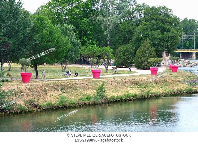 The municipal park in Agde France is an island bordered by the HERault River and the Canal du Midi