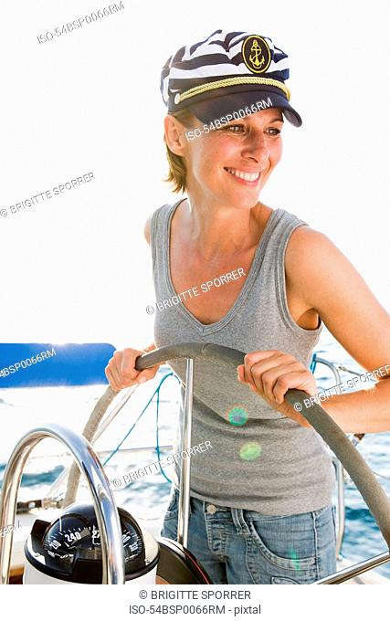 Smiling woman steering boat