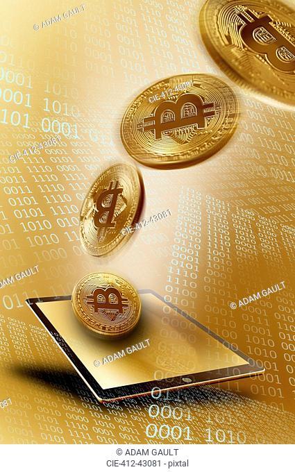 Golden Bitcoins over digital tablet
