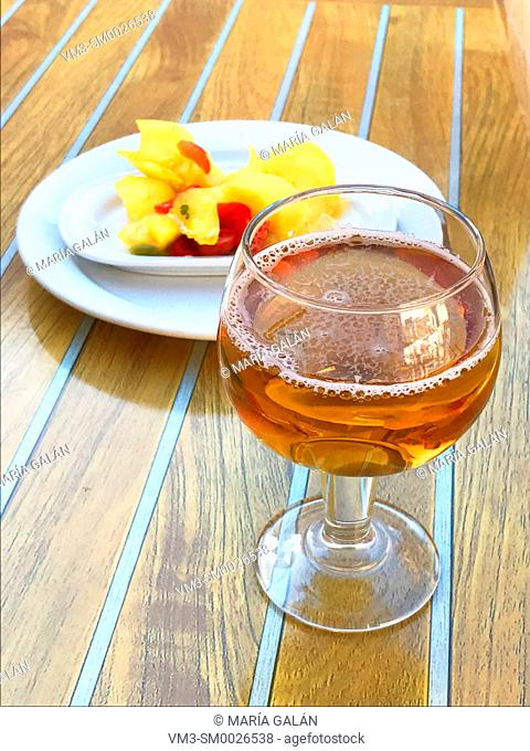 Glass of beer with tapa in a terrace. Spain