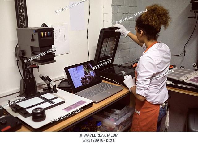 Female photographer using photo scanner