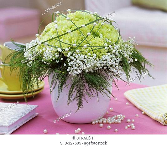 Arrangement of carnations, gypsophila, asparagus fern, bear grass
