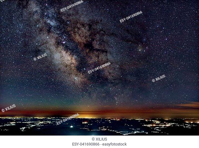 Milky Way above the city lights with pollution
