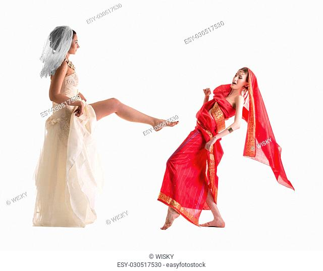 Fighting of brides, isolated on white. Modern vs. Traditional