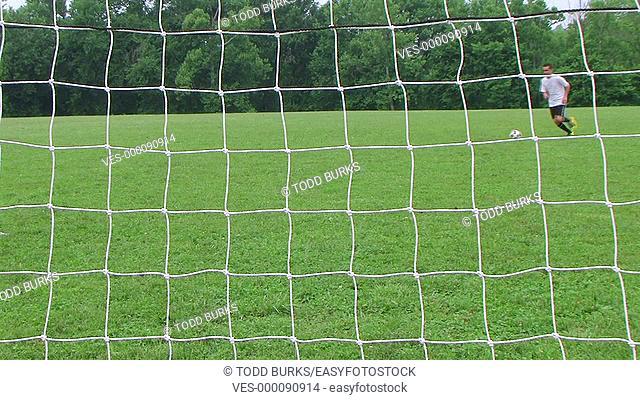 Soccer player kicks goal