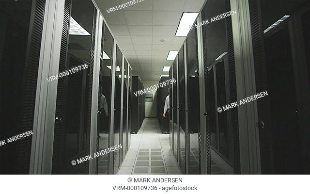 man giving a tour of a server room